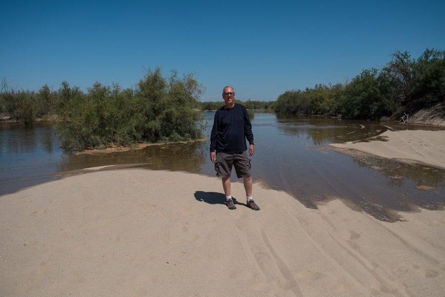 Standing in the bed of the Colorado River north of the San Luis Bridge, looking upstream at the advancing water, March 25, 2014. Juan Hernandez took this picture of me