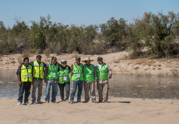 Osvel Hinojosa (second from right, in broad-brimmed hat) and crew as the pulse flow approaches San Luis, March 25, 2014