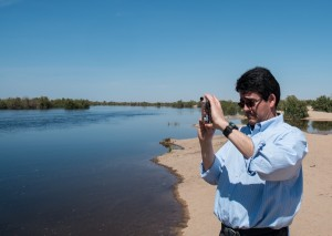 Deputy Interior Secretary Mike Connor watches water flow through the normally dry Colorado River bed at San Luis, on the U.S.-Mexico border, March 28 2014, photo by John Fleck