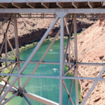 Downstream from Glen Canyon Dam, the Colorado River is green not the red of its name. Navajo Bridge, May 2017, photo by John Fleck