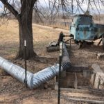 an old pickup in Valencia County, New Mexico, in the Rio Grande Valley south of Albuquerque, repurposed as a water pump