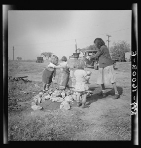 Water supply. Migratory camp for cotton pickers. San Joaquin Valley, California. American River camp. by Dorothea Lange, Farm Security Administration, 1936