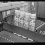 Walker Evans, 1938. Newspapers for sale at a grocery, 324 East Sixty-first Street, New York, New York