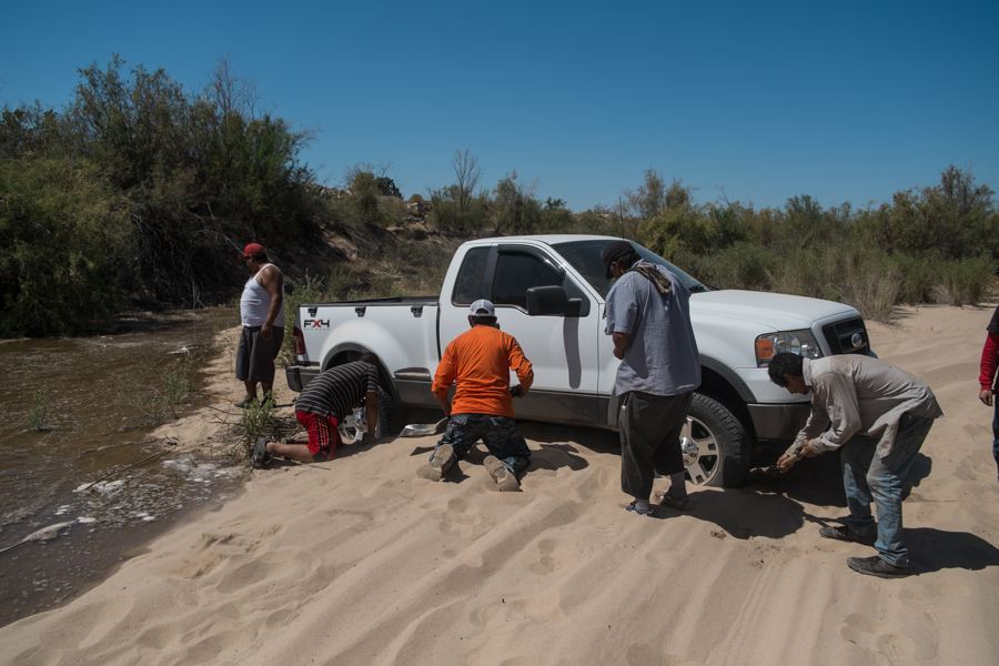 Pickup stuck in a sandy riverbed as the Rio Colorado arrives, March 25, 2014, by John Fleck