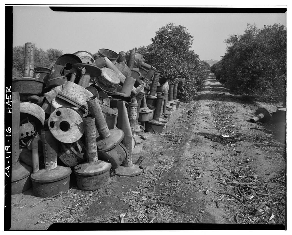 Smudge pots in orange grove on Victoria Avenue, Arlington Heights Citrus Landscape, Southwestern portion of city of Riverside, Riverside, Riverside County, CA, photo by Brian Grogan, courtesy Library of Congress